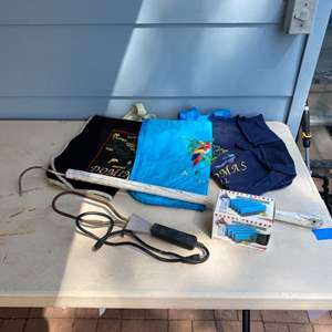 Lot # 221 - Electric charcoal starter, large barbecue pick, grill cleaner and embroidered travel bags