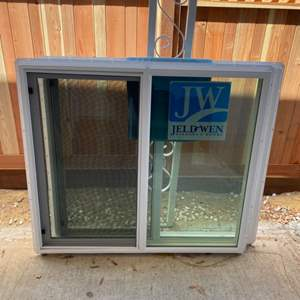 """Lot # 226 - Two new 47.5""""x41.5"""" White vinyl, left-handed sliding, double pane windows with screens by Jeld Wen"""