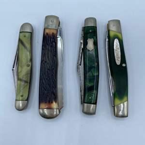 Lot # 250 - Four Remington folding pocket knives