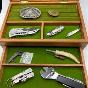 Lot # 261 - Box full of knives, multi tools and belt buckles