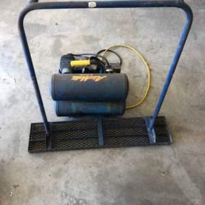 Lot # 53 - Emglo Air Compressor and Concrete Stomper