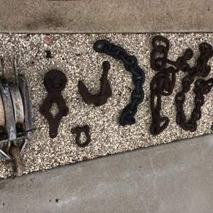 Lot # 62 - Maritime block and pulley / Anchor chains and other fence hanging items