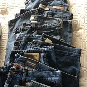 Lot # 120 - Levi's, Lands' End, Eddie Bauer..Mens Clothing-shorts & T-shirts and Travel Bags