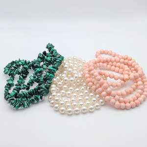 Lot # 100 - Three Long Beaded Necklaces