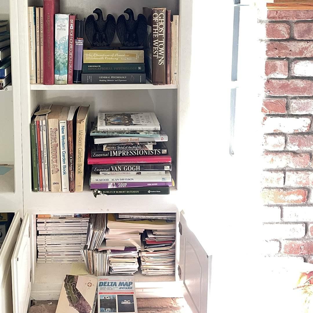 Lot # 55 - Iron Eagle Bookends and Books (main image)