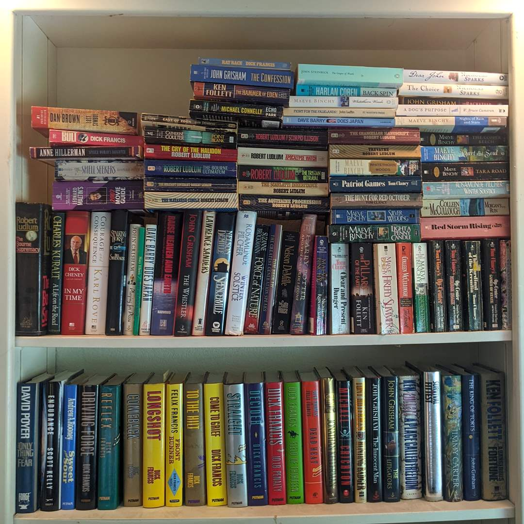 Lot # 105 - 2 Shelves Filled With Novels  (main image)