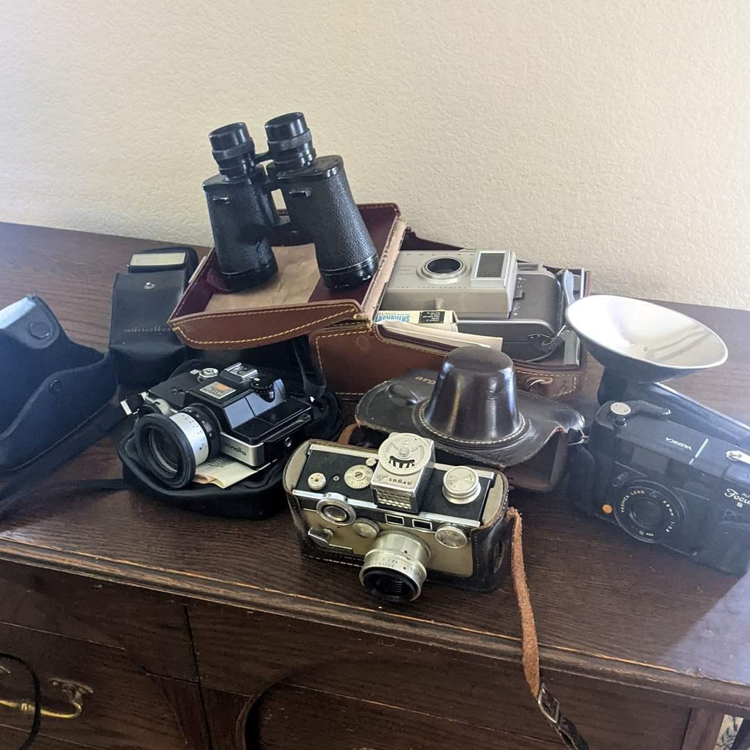Lot # 110 - Vintage Cameras, Binoculars, Polaroid, Argus, Yashica and Minolta  (main image)
