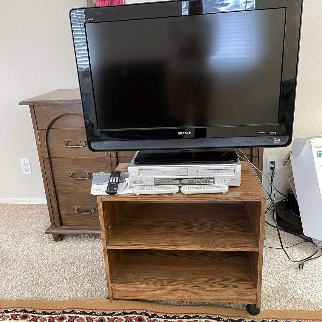 Lot # 126 - Sony Bravia TV, Stand, DVD VCR Combo (main image)