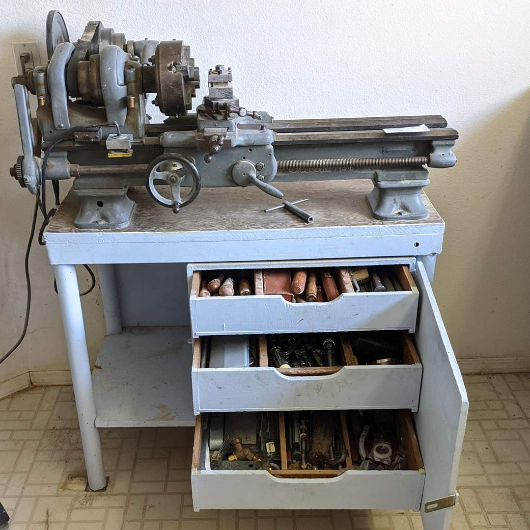 Lot # 169 - WWII Lathe, Bench and All Tools in Bench Cabinets (main image)