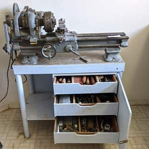 Lot # 169 - WWII Lathe, Bench and All Tools in Bench Cabinets
