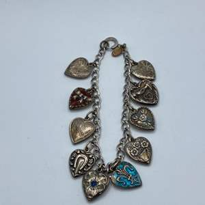 Lot #  15 - Sterling bracelet with Sterling heart charms(20.7g)