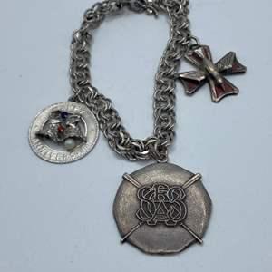 Lot #  16 - Sterling charm bracelet (41.5g)