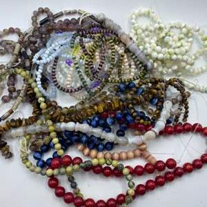 Lot #  50 - Red coral, tigers eye and other stone beads