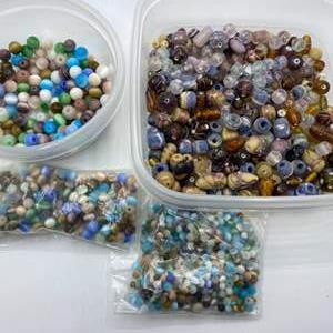 Lot #  54 - Matching beads in three different sizes plus grouping of glass beads