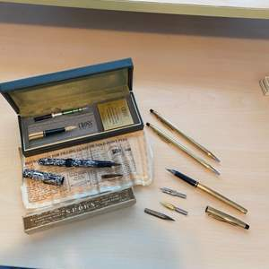 Lot # 102 - Fountain pens with various tips and Cross pen/pencil set