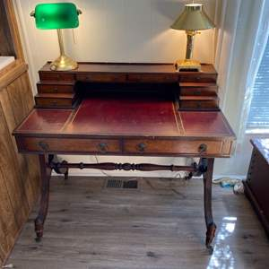 Lot # 181 - Antique desk with desk lamps and drawer goods