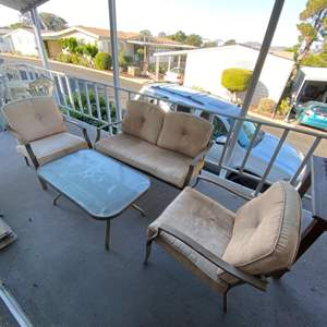 Lot # 187 - Outdoor set; Love seat, two chairs and table