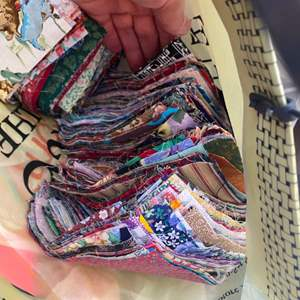 Lot # 237 - Tub full of great stuff! Quilting squares, needlepoint, fabrics