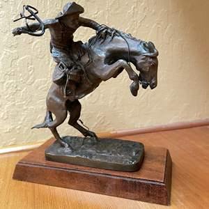"""Lot # 27 - """"The Bronco Buster"""" Bronze Statue from the Fredric Remington museum"""
