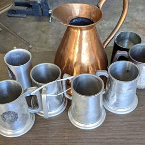 Lot # 170 - Copper Pitcher and and Variety of Metal Tavern Steins (Some have Glass Bottoms)