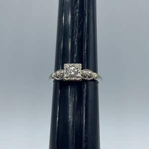 Lot # 13 - Wedding band in 14k white gold (2.5g) .20c diamond