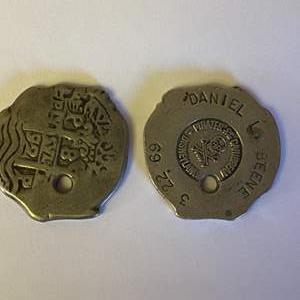 Lot # 32 - Two 1969 Disneyland Pirates of the Caribbean tokens