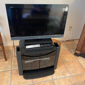 Lot # 82 - Sony TV with stand