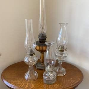 Lot # 99 - Four oil lamps including Aladdin lamp
