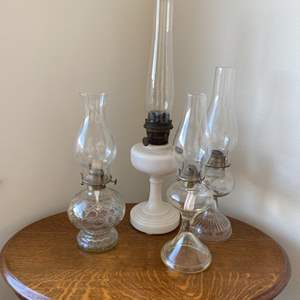 Lot # 100 - Four oil lamps including an Aladdin lamp