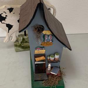 Lot # 188 - Wooden fishing shack and a cow