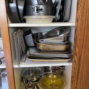 Lot # 207 - Large baking lot; spring pans, insulated cookie sheets, plus muffin tins, stacking bowls and cooking pots