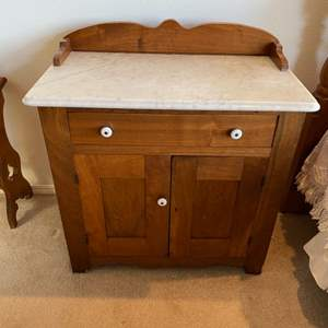 Lot # 219 - Marble top cabinet