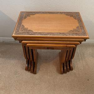 Lot # 251 - Four ornate nesting tables with drawer