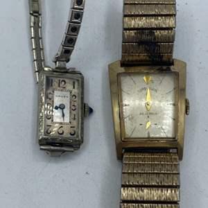 Lot # 344 - Lord Elgin 23 jewel and Gruen ladies watch with sapphire stem (needs repair)