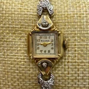 Lot # 351 - Bulova 14k gold watch with diamonds