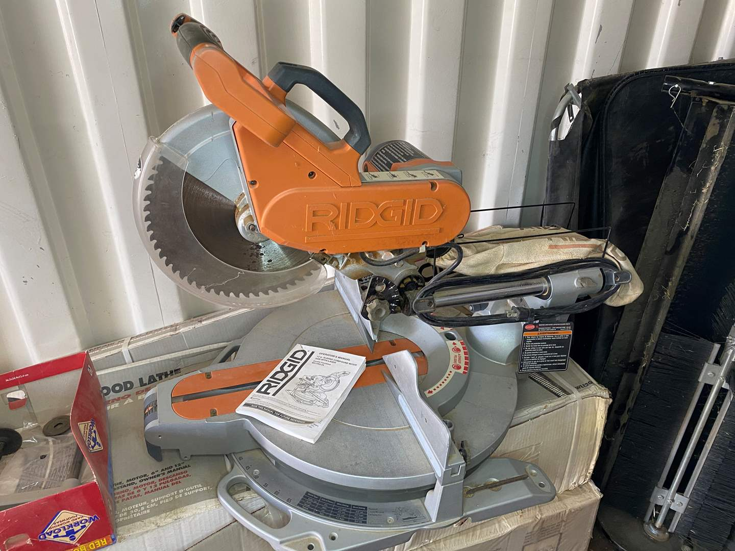"Lot # 21 - RIDGID 12"" SLIDING COMPOUND MITER SAW WITH LASER (main image)"