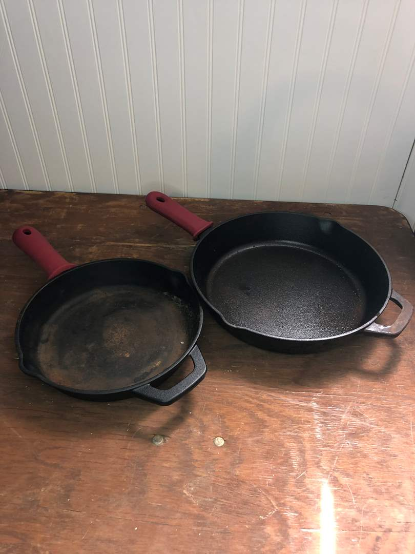 Lot # 32 - CAST IRON SKILLETS W/SILICON HANDLE COVERS (main image)