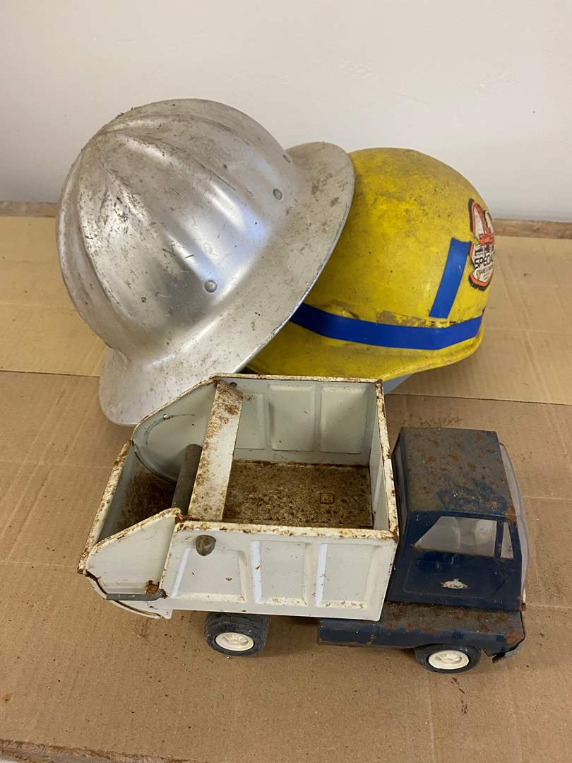Lot # 21 - HARD HATS & TOY TRUCK (main image)