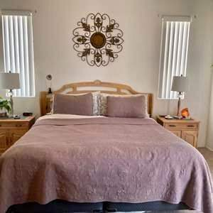 Lot # 22-King size bed with nightstands- Mattress is in great condition