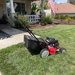 Lot # 117- Troy-Bilt lawn mower with bag in excellent condition!