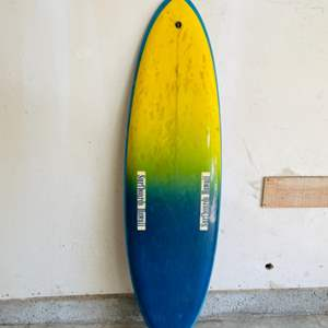 Lot # 118- Surf's up! Beautiful costume surfboard