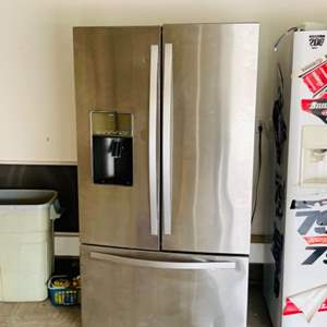 Lot # 125- Stainless steel Whirlpool refrigerator