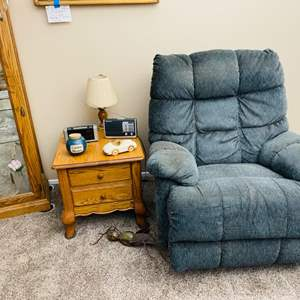Lot#65- End table and Recliner with fun collectibles: Vintage radio, Door blocker Ant, lamp and more