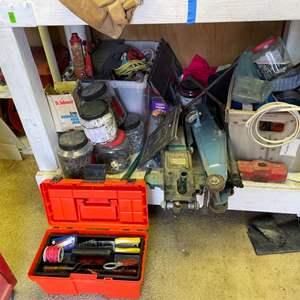 "Lot # 308- 5 ton hydraulic bottle jack, a 4000 lb. floor jack, and a 15 5/8"" green lifting floor jack. Bottom Shelf Contents"