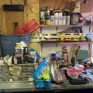 Lot # 314-  Includes wrenches, levels, nuts, bolts, staples, sockets, and a creeper.
