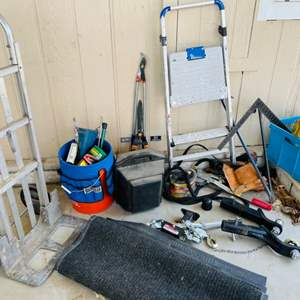 Lot # 319- car buffer/ polisher in its case, a tool belt, a winch puller, an aluminum dolly, a hose, a bucket with holder, (2) h