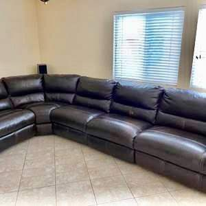 Lot # 17- Bassett brown leather sectional sofa with motorized reclining!