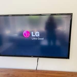 """Lot # 23- LG 60"""" Flatscreen T.V."""