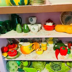 Lot # 39- Two Shelves Worth of Assorted Fruit and Vegetable Pottery Pieces