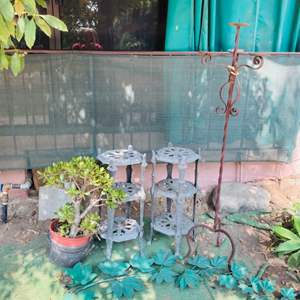 Lot # 177-Vintage Outdoor End Tables, Potted Plant, candelabra, and More!
